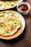 Omelette / omelette chapati roll or Indian bread or roti rolled with omlet. Stock Images