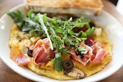 Omelette with parma ham and salad. On a plate stock photos