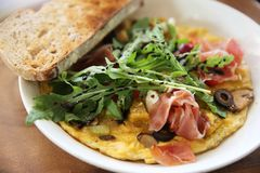 Omelette with parma ham and salad. On a plate stock image