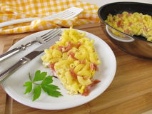 Omelette with pasta, eggs an ham Stock Images