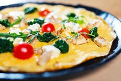 Omelette in a plate on wooden table. Omelette in a plate on the wooden table stock photo