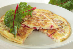 Omelette with a red chard Royalty Free Stock Images