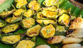 Omelette With Rice. Barbecued omelette in banana leaf with rice stick Stock Photography