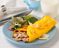 Omelette. With roasted mushrooms and salad stock photos