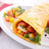 Omelette rolled with vegetables royalty free stock images