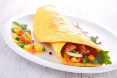 Omelette rolled with vegetables royalty free stock image