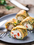 Omelette rolls with curd Stock Photos