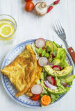 Omelette with salad and lemon water breakfast meal Royalty Free Stock Photo