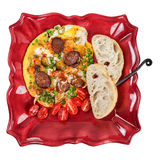 Omelette with sausage on plate Royalty Free Stock Image