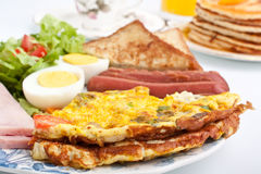 Omelette with Sausages and Bolied Eggs Stock Photo