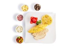 Omelette or scrambled egg Stock Images
