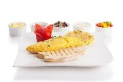 Omelette or scrambled egg Stock Photo