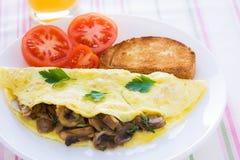 Omelette serica piegata dei funghi Immagini Stock Libere da Diritti
