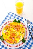 Omelette with slices of sausage and tomato Royalty Free Stock Photography