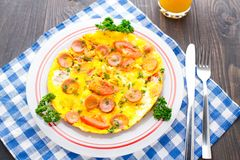 Omelette with slices of sausage and tomato Stock Photography