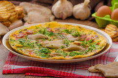 Omelette with smoked meat and mushrooms Royalty Free Stock Photo
