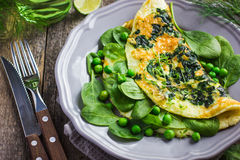 Omelette with spinach and green peas Stock Images