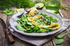 Omelette with spinach and green peas Stock Photography