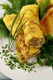 omelette staczający się fotografia stock