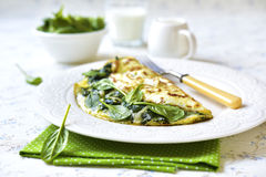 Omelette stuffed with spinach and cheese. Stock Photography