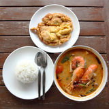 Omelette,Tom Yam Kung,and steam rice on the wood table Royalty Free Stock Photography
