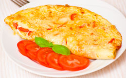 Omelette. With tomato on plate Royalty Free Stock Photo