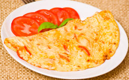 Omelette. With tomato on plate Royalty Free Stock Image