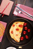 Omelette with tomatoes Stock Photo