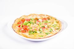 Omelette on a plate. Omelette with tomatoes and fresh corn salad on a white background stock photos