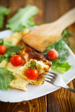 Omelette with tomatoes and lettuce Royalty Free Stock Photography