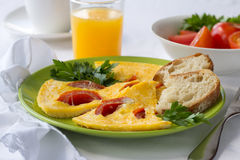 Omelette with tomatoes Stock Images