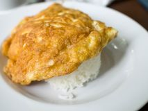 Omelette topped with rice. Thai food omelette topped with rice royalty free stock photos