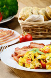 Omelette with vegetables and fried bacon Royalty Free Stock Photos