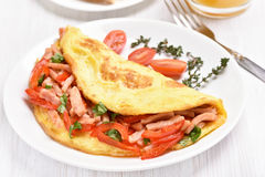 Omelette with vegetables and ham Stock Images