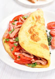 Omelette with vegetables and ham Royalty Free Stock Images