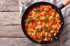 Omelette with vegetables in a pan close-up. top view horizontal Royalty Free Stock Photo