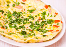 Omelette. With vegetables on plate Royalty Free Stock Photo