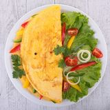 Omelette and vegetables royalty free stock photo