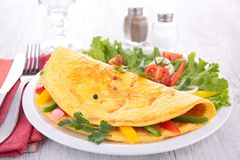 Omelette and vegetables stock images