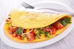 Omelette and vegetables Stock Photos