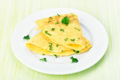 Omelette on white plate Stock Photos