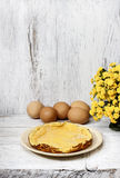 Omelette on white wooden table Royalty Free Stock Images