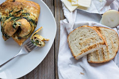 Omelette with wild mushrooms and spinach Royalty Free Stock Image