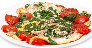 Omelette z pomidorami na talerzu Obrazy Royalty Free