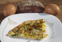 Omelette with zucchini and bacon Stock Photography