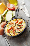 Omelette with zucchini and tomatoes Royalty Free Stock Photography