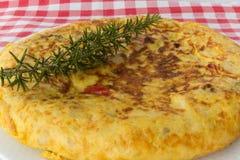 omelettlökpotatis Arkivbild