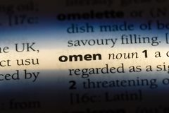 Omen. Word in a dictionary.  concept stock images