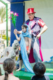 Omer (Beer-Sheva), ISRAEL - The boy, clown, two white poodle on a stage show magic tricks for children July 25, 2015 Stock Photos