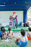 Omer (Beer-Sheva), ISRAEL -Children sitting on the grass and two clowns on the summer stage, July 25, 2015 Royalty Free Stock Photography